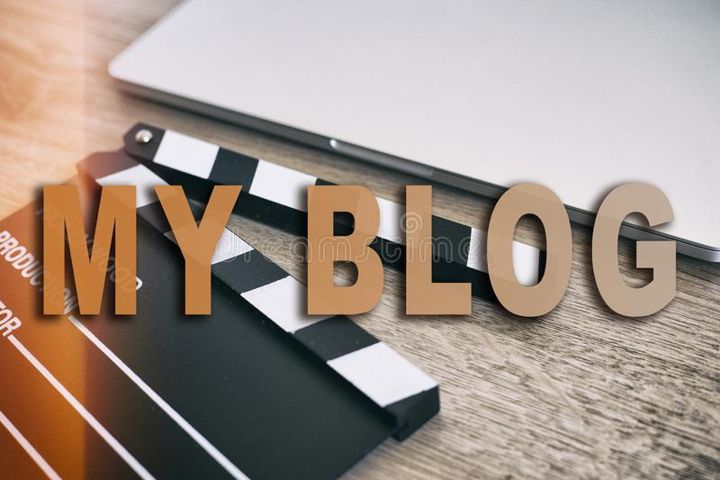 Movie clapper and laptop on the wood table. Words MY BLOG royalty free stock photo