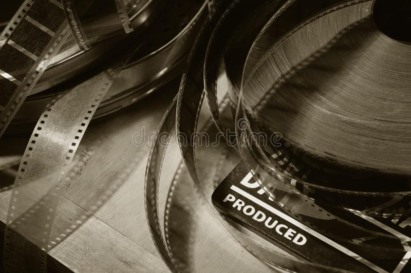 Movie clapper and old film reel on a wooden background royalty free stock photography