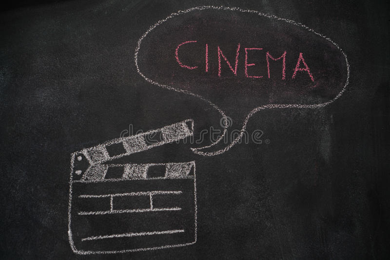 Movie clapper with speech bubble on chalkboard stock photo