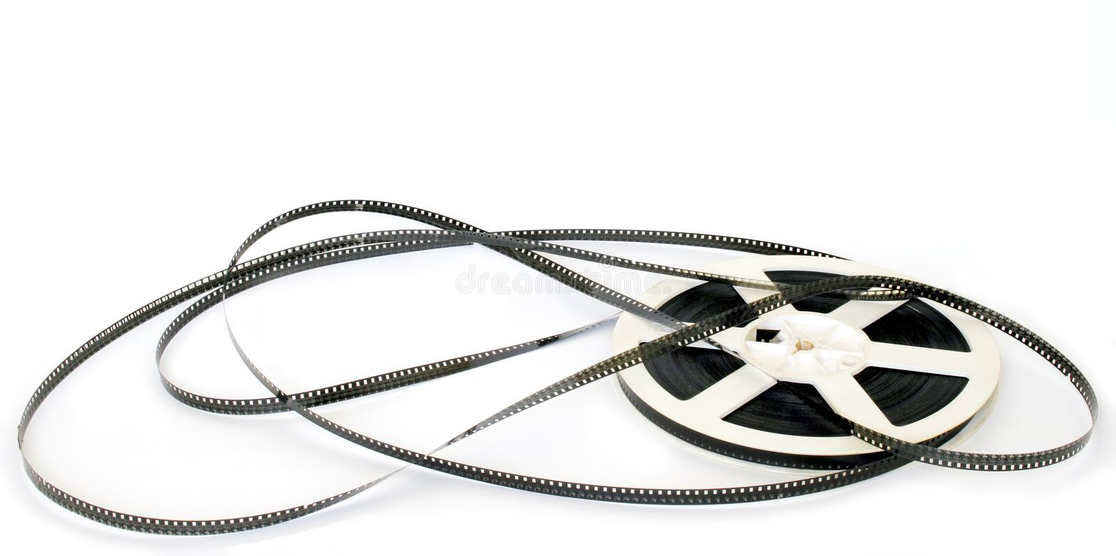 Movie film. Is uncoilled from spool on white background stock images
