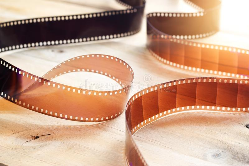 Movie film strips on wooden background royalty free stock images