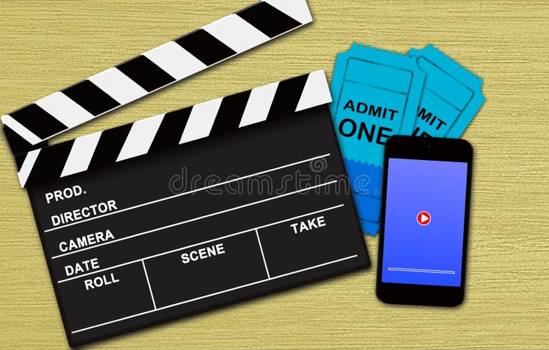 Movie online booking concept. On wooden background royalty free stock photo