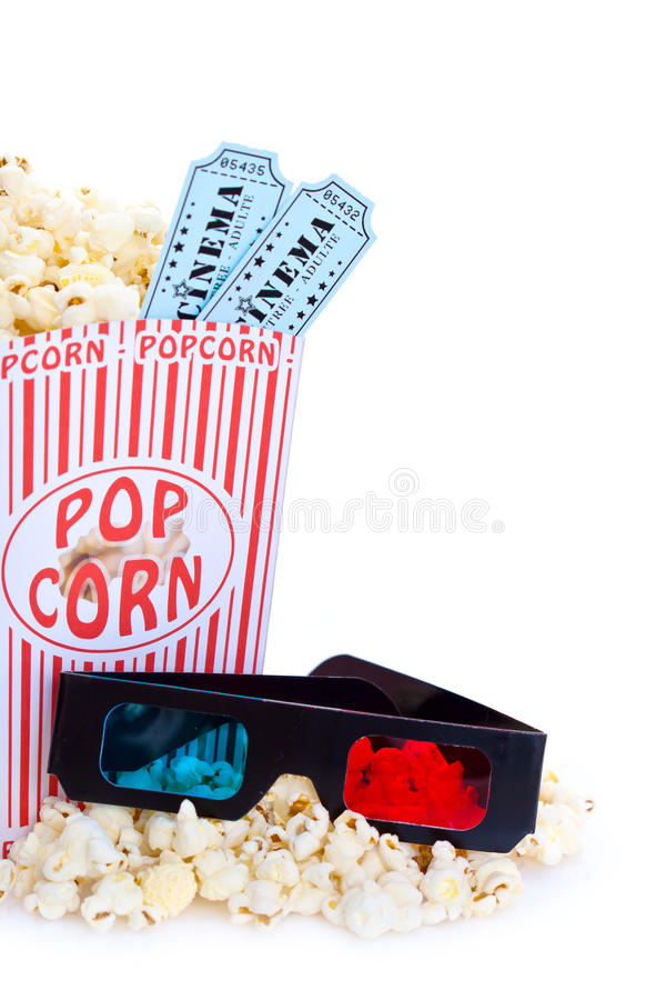 Movie popcorn and 3D glasses stock images