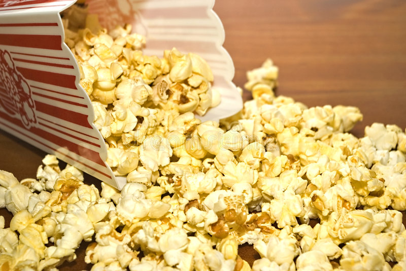 MOVIE POPCORN. Buttered movie popcorn in a popcorn cup stock photo