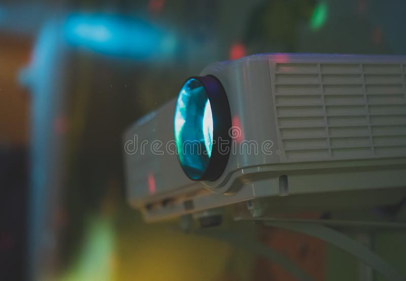Movie projector. Movie projector in action mounted on the wall stock image