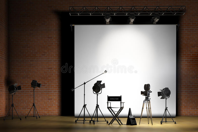 Movie Set. Inside a sound stage with movie lights, movie camera, boom mic, director's chair, megaphone and clapper board