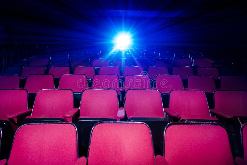 Movie Theater with empty seats and projector royalty free stock photography