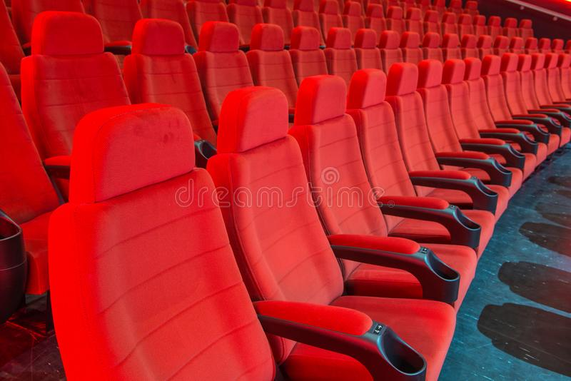Movie Theatre seating with armrests and drink holders royalty free stock images