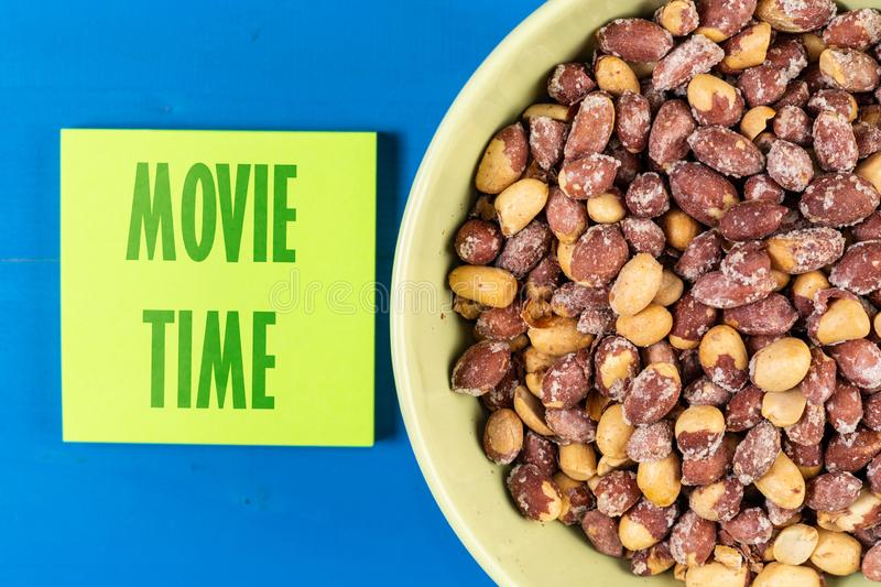 Movie Time Concept Text With Peanuts In The Bowl royalty free stock image
