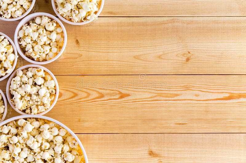 Movies background with popcorn bowls on table stock images