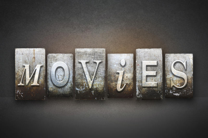 Movies Letterpress. The word MOVIES written in vintage letterpress type stock images