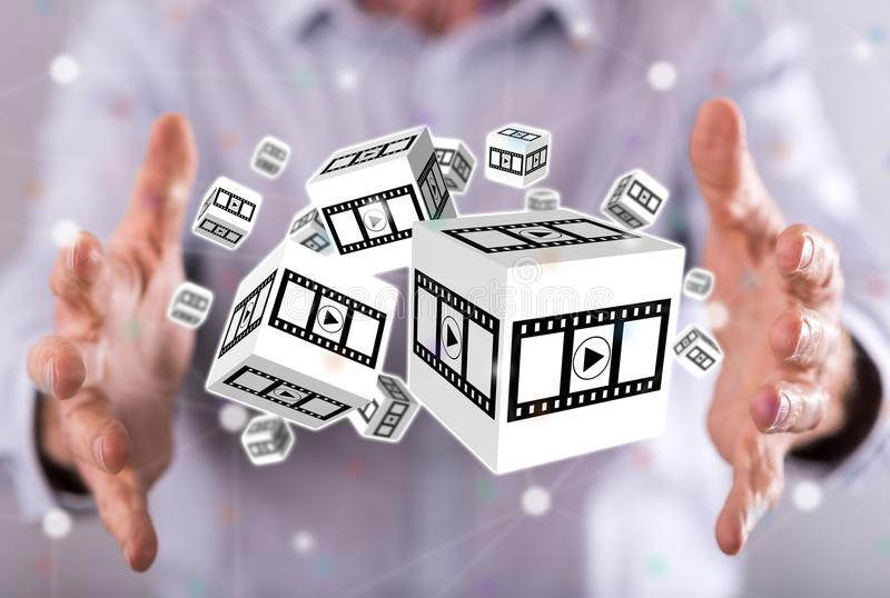 Concept of movies, video and cinema. Movies, video and cinema concept between hands of a man in background royalty free stock image