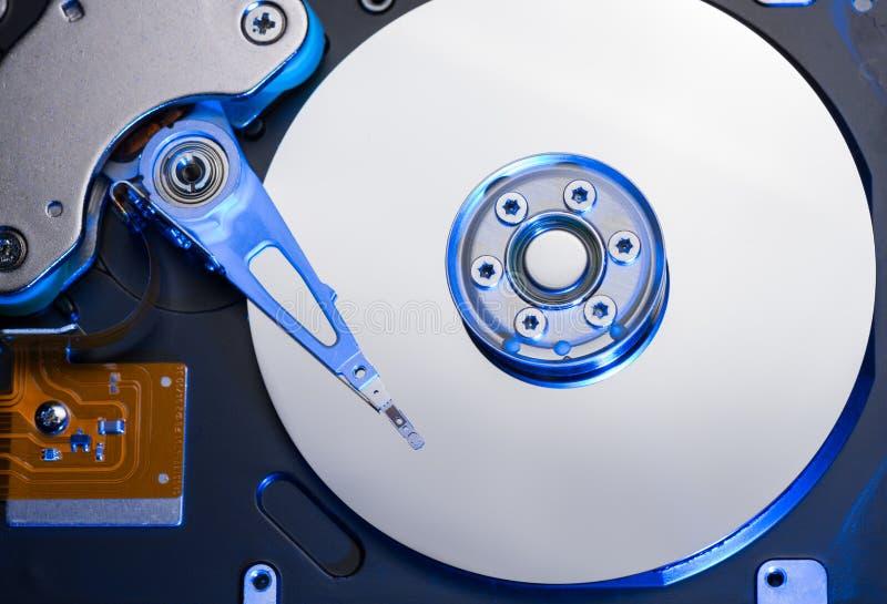 Movimentação de disco rígido na luz azul imagem de stock royalty free