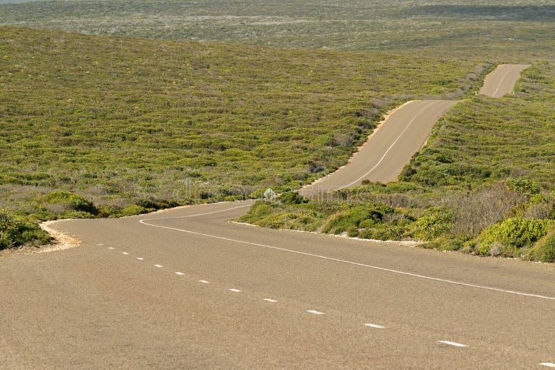 Movimentação do pugilista, estrada ondulada ventosa na ilha do canguru, Austra sul fotos de stock