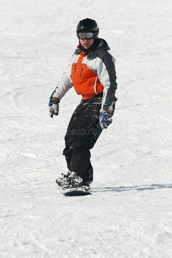 Movimentação do Snowboarder uma placa fotos de stock