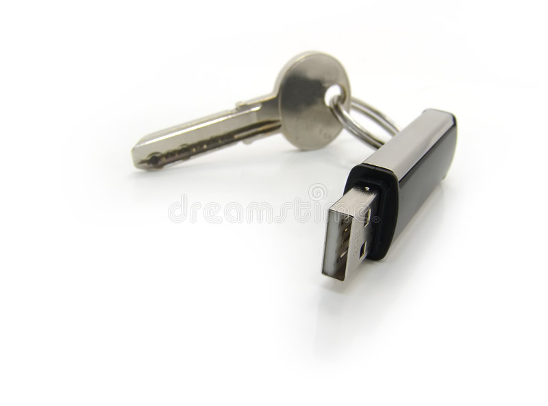 Movimentação do USB com uma chave. Macro fotografia de stock royalty free
