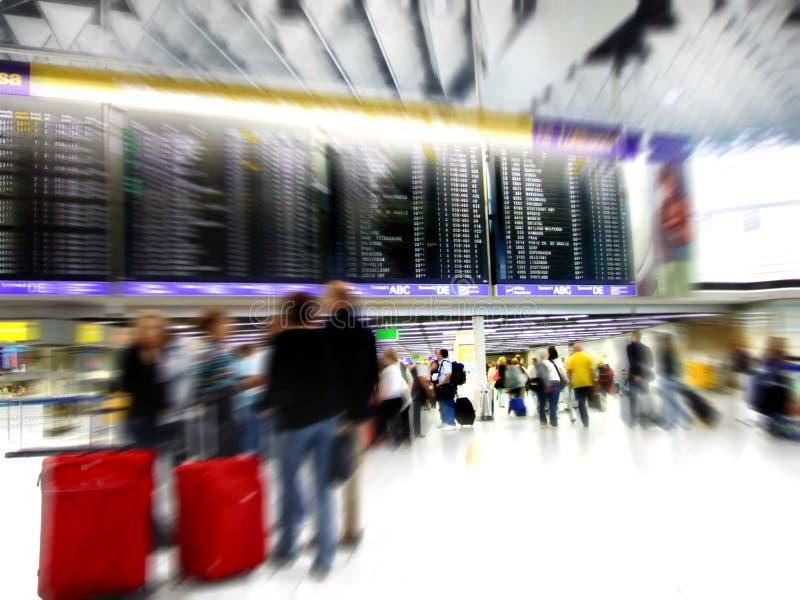 movimento della folla della sfuocatura dell'aeroporto fotografia stock