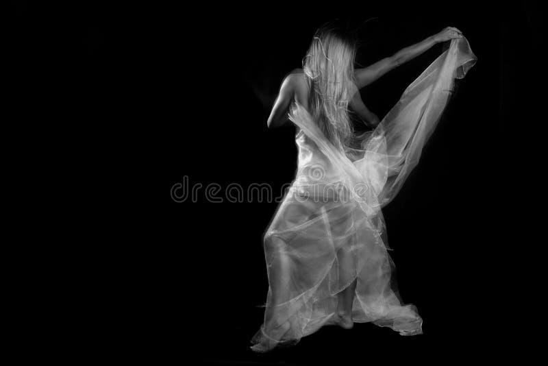 Movimiento con las telas transparentes y la exposición larga imágenes de archivo libres de regalías