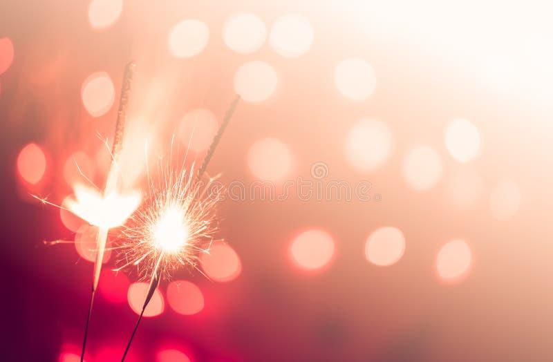 Movimiento de la Navidad y de la chispa newyear del partido foto de archivo