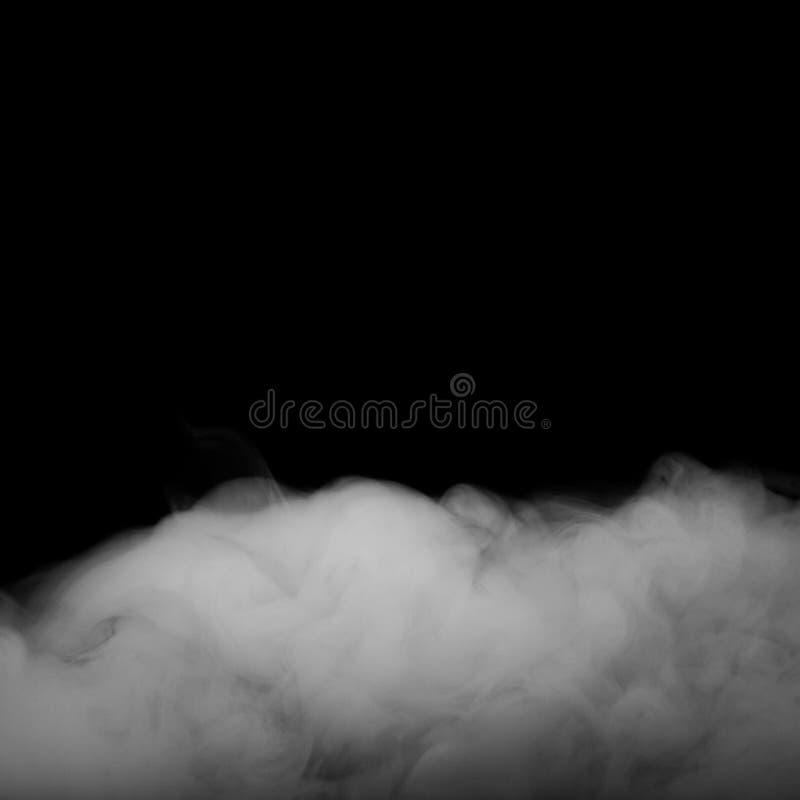 movimiento de la niebla o del humo en fondo negro del color fotos de archivo libres de regalías