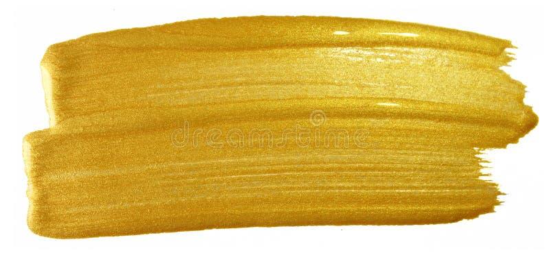 Movimiento de la pintura del cepillo del oro Mancha de oro de acrílico de la mancha del color en el fondo blanco Bandera del oro  imagen de archivo