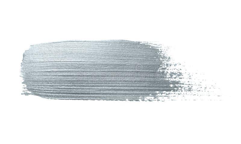 Movimiento de plata de la brocha o mancha abstracta del lenguado con la textura de plata de la mancha del brillo en el fondo blan imagen de archivo libre de regalías