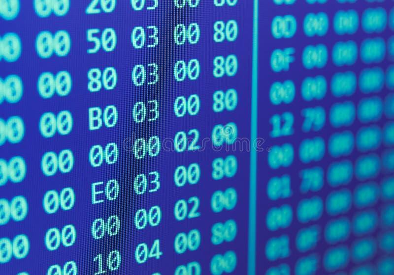Movimiento en sentido vertical hexadecimal del código de programa imagen de archivo