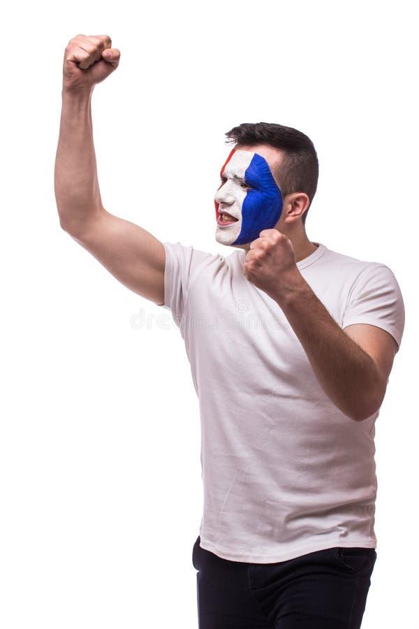 Movimiento eufórico lateral del fanático del fútbol de Francia en juego del triunfo o de la cuenta del equipo nacional de Francia imagen de archivo