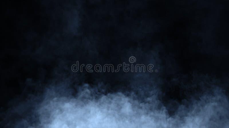 Movimientos azules abstractos del vapor del humo en un fondo negro El concepto de aromatherapy Elemento del dise?o foto de archivo libre de regalías