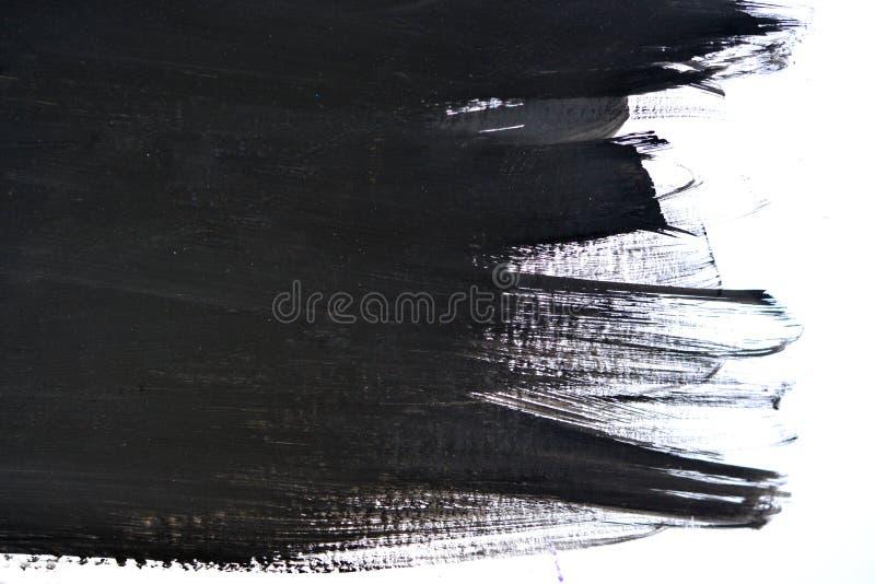 Movimientos negros del cepillo en el Libro Blanco imagen de archivo libre de regalías