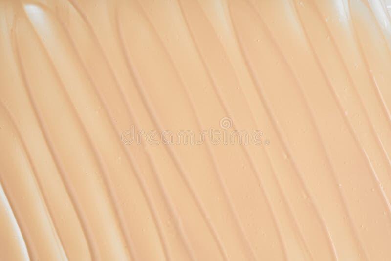 Movimientos y textura suavemente beige del lápiz corrector foto de archivo