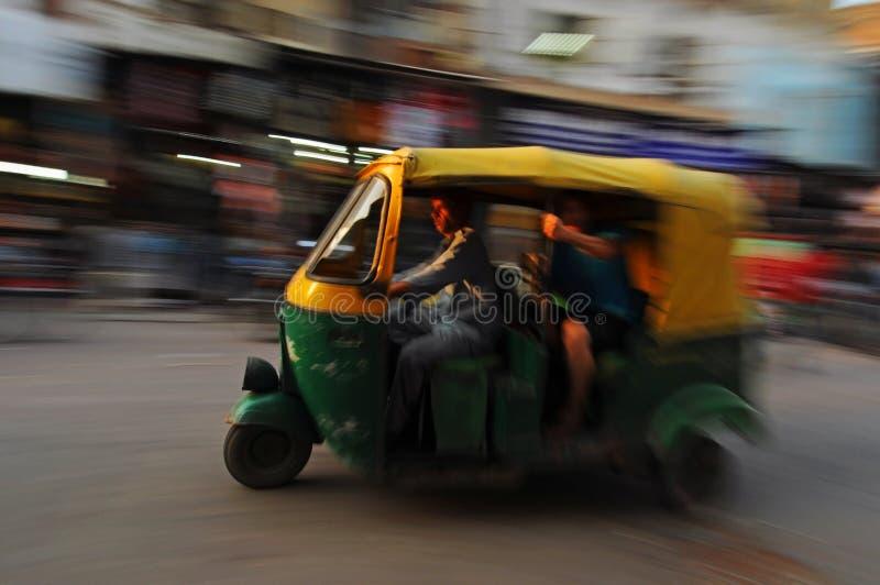 Moving auto rickshaw, Old Delhi, India royalty free stock images