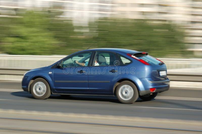 Moving blue car stock photos