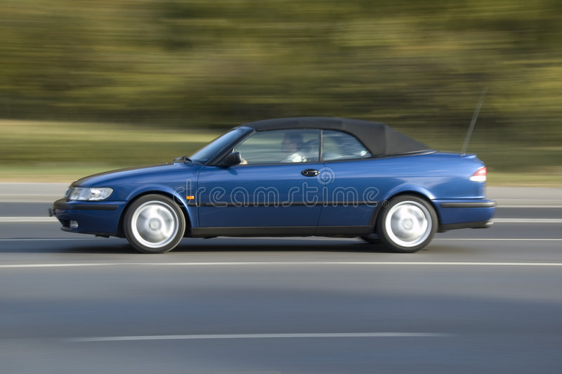 Moving blue car stock photo