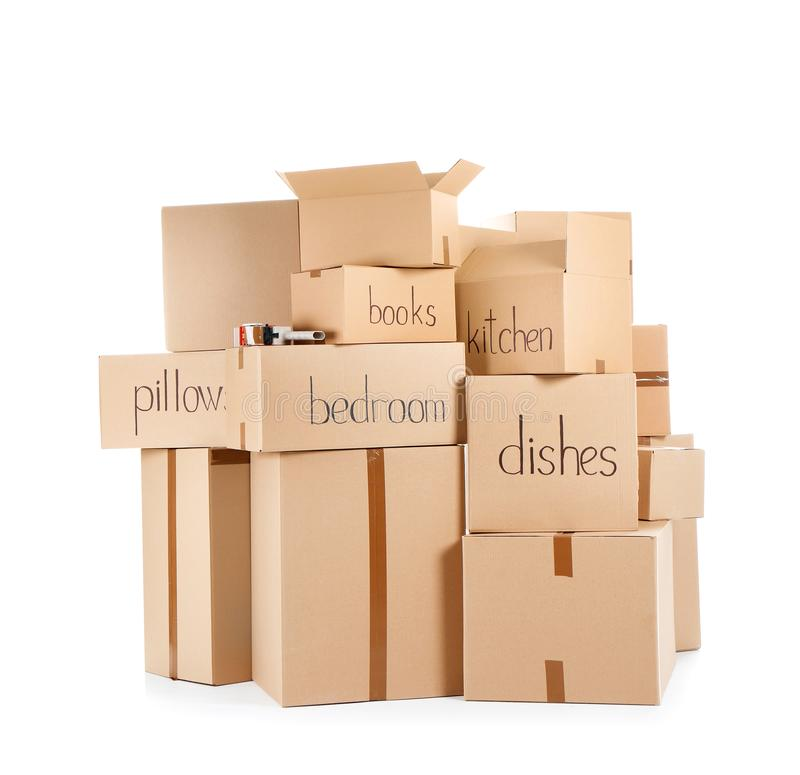 Moving boxes and adhesive tape dispenser. On white background stock photos