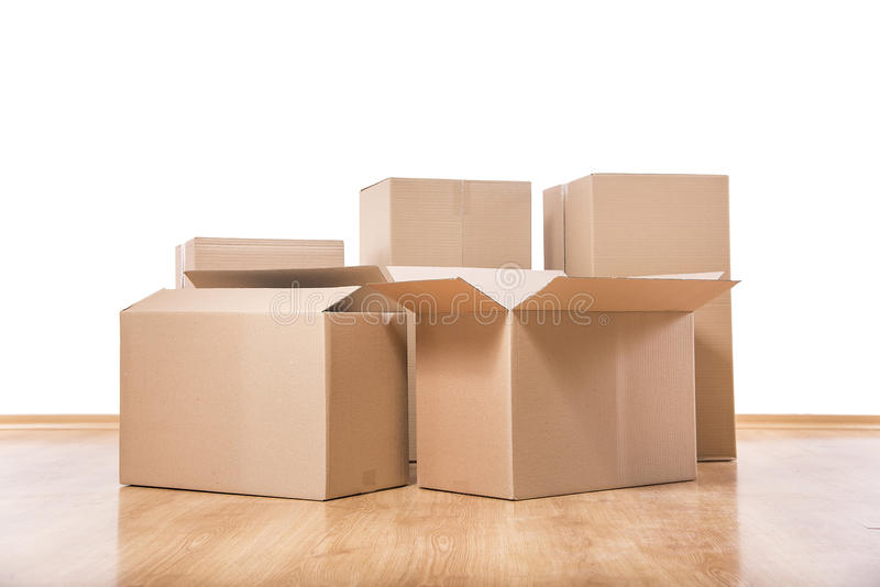 Moving boxes on the floor stock images