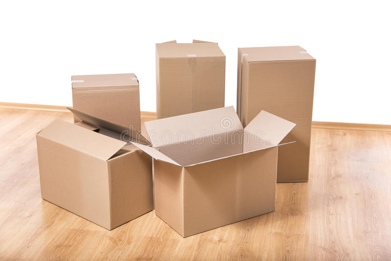 Moving boxes on the floor stock image