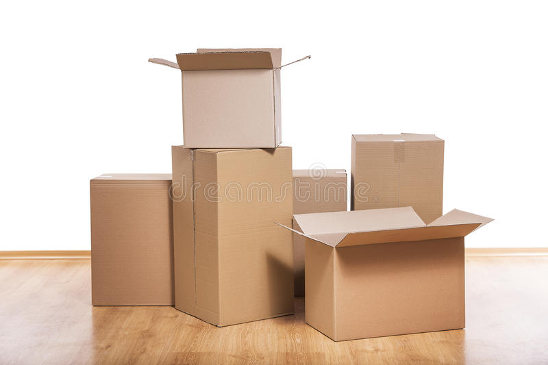 Moving boxes on the floor royalty free stock images