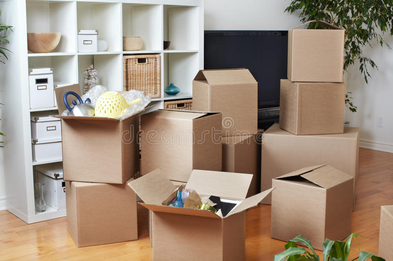 Moving boxes in new house. Moving boxes in new apartment. Real estate concept stock photo