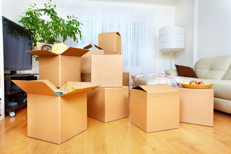 Moving boxes in new house. Moving boxes in new apartment. Real estate concept royalty free stock images