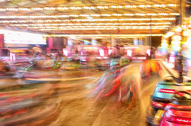 Motion blur, vibrant coloured bumper cars, dodgems. Velez Malaga fair, Spain. Moving the camera to add a motion blur effect, accentuating the movement of the stock images