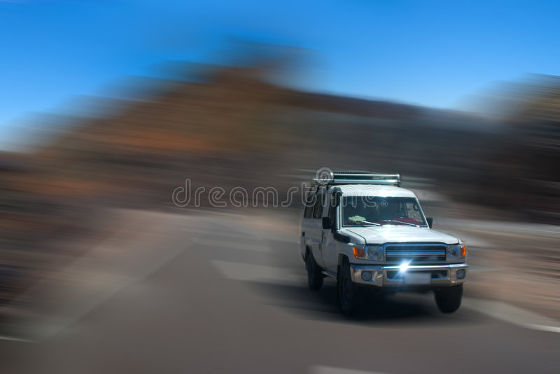 Moving car. White off-road car with motion blur stock photography