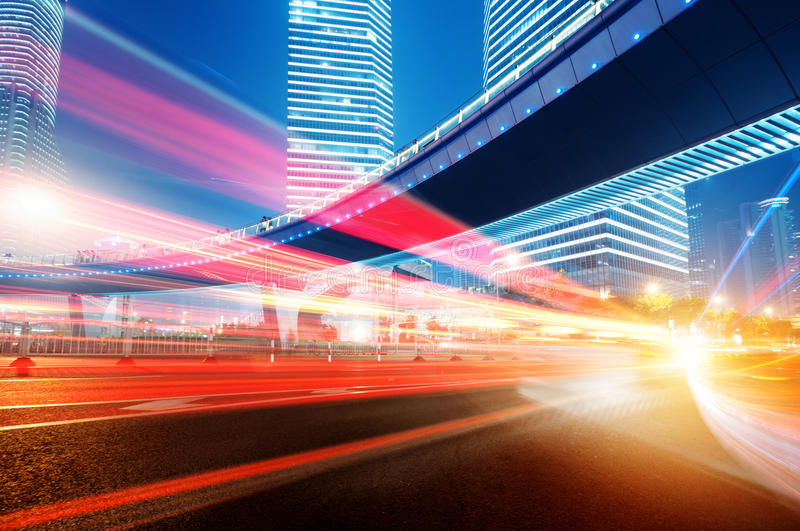 Moving car with blur light. Through city at night stock photography