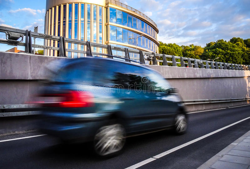Moving car. In city near modern building royalty free stock photography