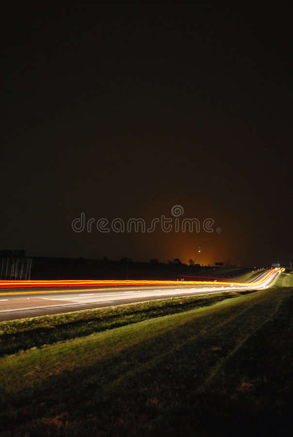 Moving cars lights night scene. Night scene of cars lights in movement along the road royalty free stock image