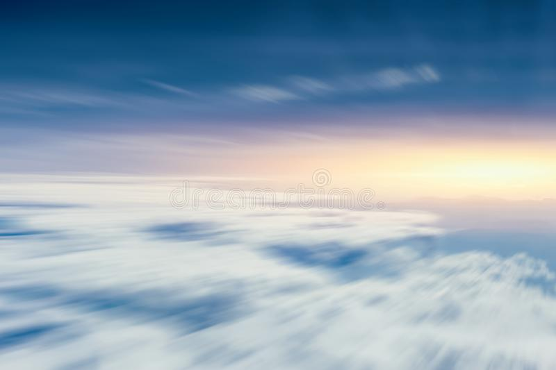 Moving cloud sky view from aircraft for going future. And forward concept background royalty free stock image