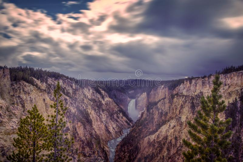 Moving Clouds over Upper Canyon Falls in Yellowstone National Park stock image
