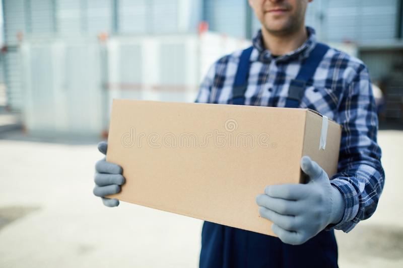 Moving company worker with box royalty free stock photo