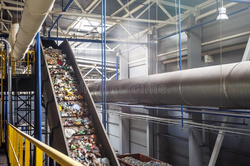 Moving conveyor transporter on Modern waste recycling processing plant. Separate and sorting garbage collection. Recycling and. Storage of waste for further stock photos