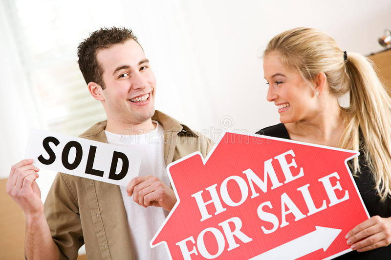 Moving: Couple Excited To Sell Home royalty free stock images